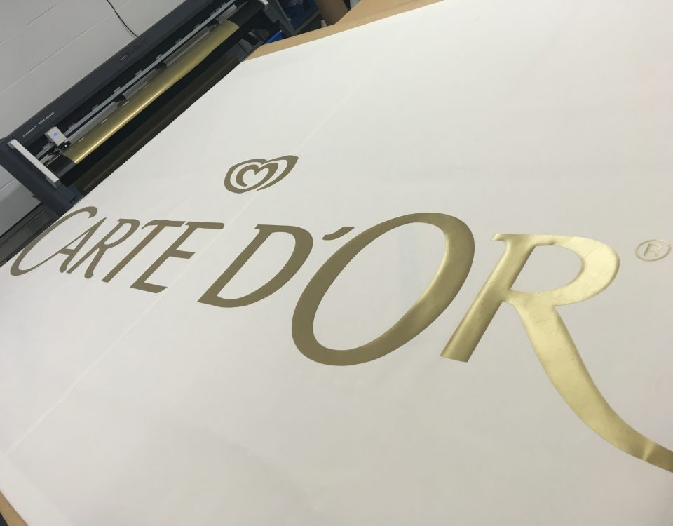 Cream awning cover branded with the Carte d'Or logo printed in gold by Parker Masters Ltd.