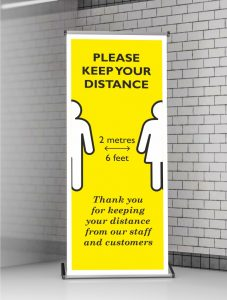 Roller Banner Stand Pop-up for Social Distancing in Operation | 2 Metres (6 Feet). Bespoke designs available on request.