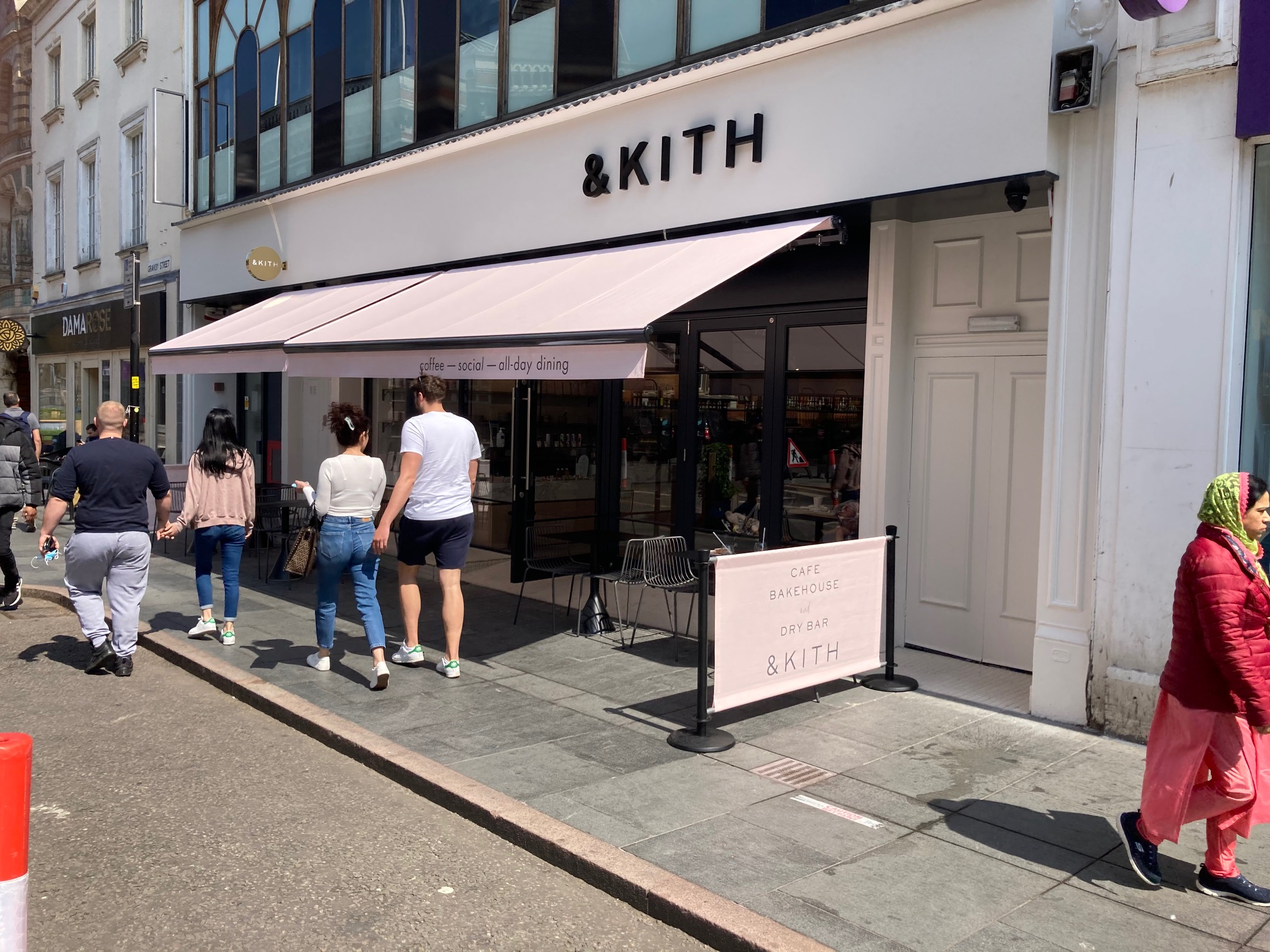 & Kith Cafe Bakehouse in Leicester City Centre. American inspired cafe and dry bar in the middle of Leicestershire. Retractable awning valance and cafe barrier banner printed in Pantone colour by Parker Masters Ltd.