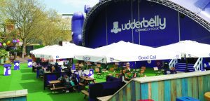 The Udderbelly Festival Cowsgate Edinburgh in Scotland. Comedy events at the Edinburgh Fringe. Large parasols branded with Fosters Larger logo's